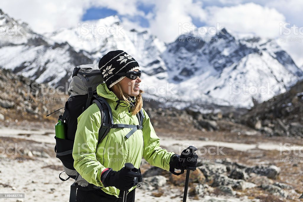 Woman hiking in mountains, Nepal royalty-free stock photo