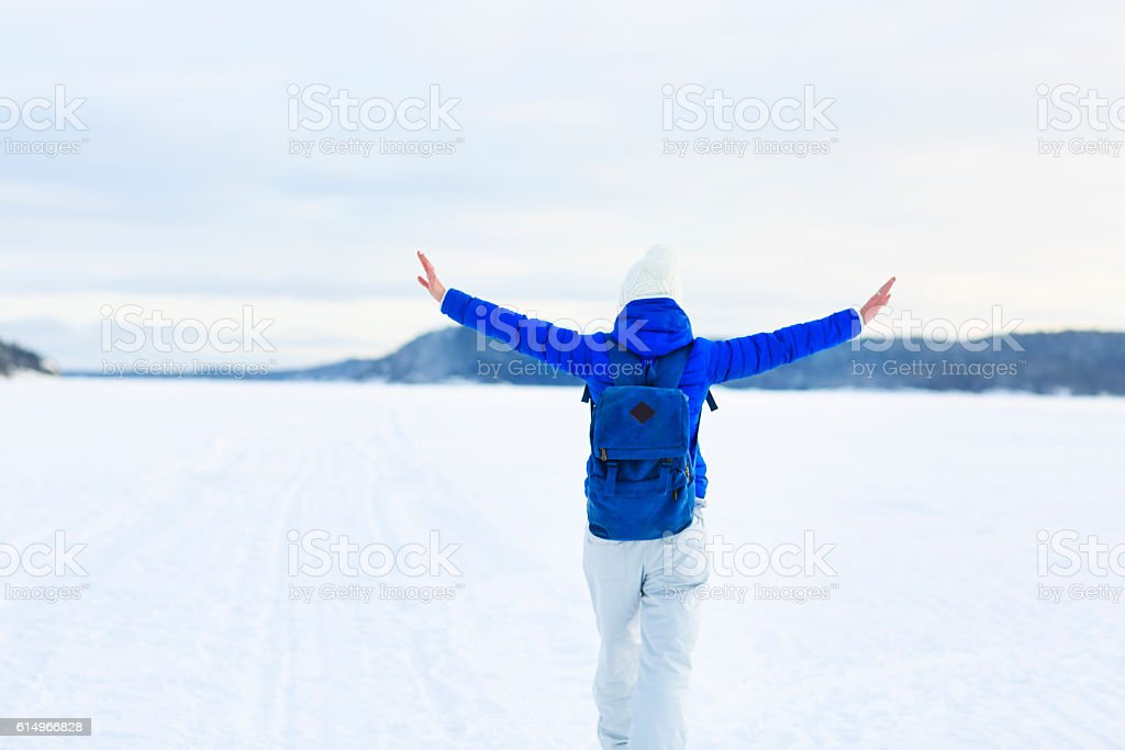 Woman hiking in white winter forest stock photo