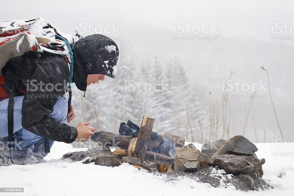 Starting a Fire in Snow stock photo