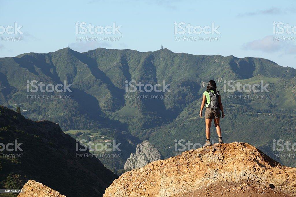 Woman hiking on St Helena Island near central peaks stock photo