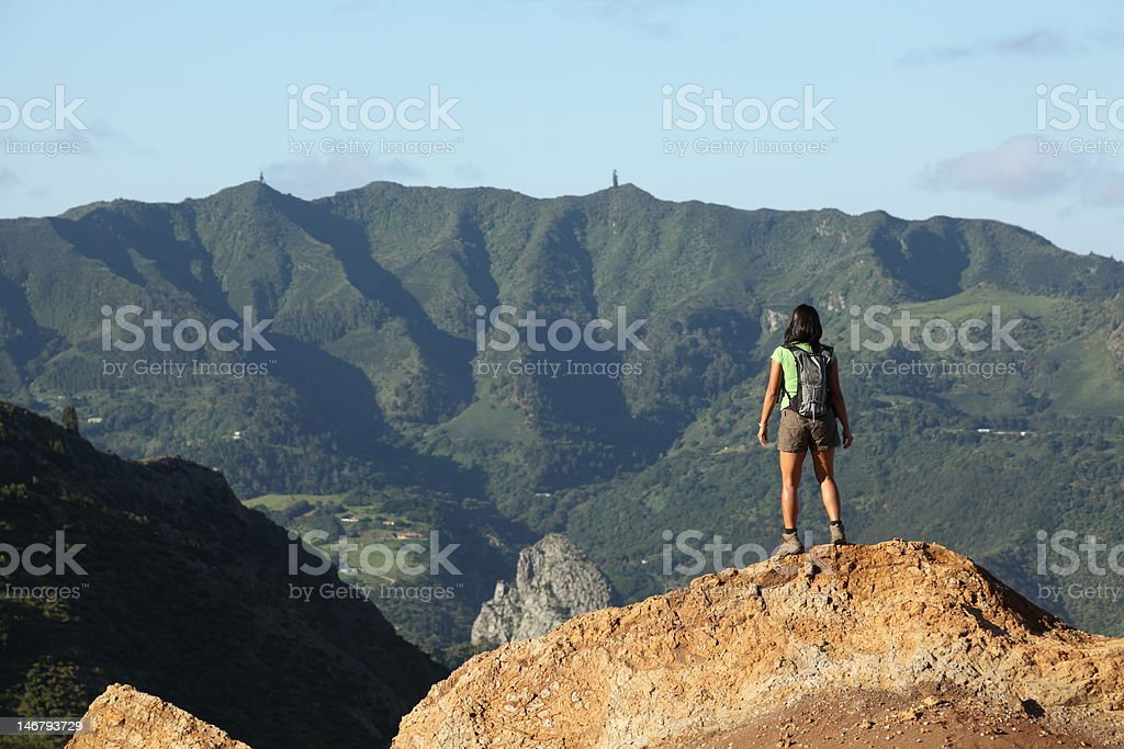 Woman hiking on St Helena Island near central peaks stock photo