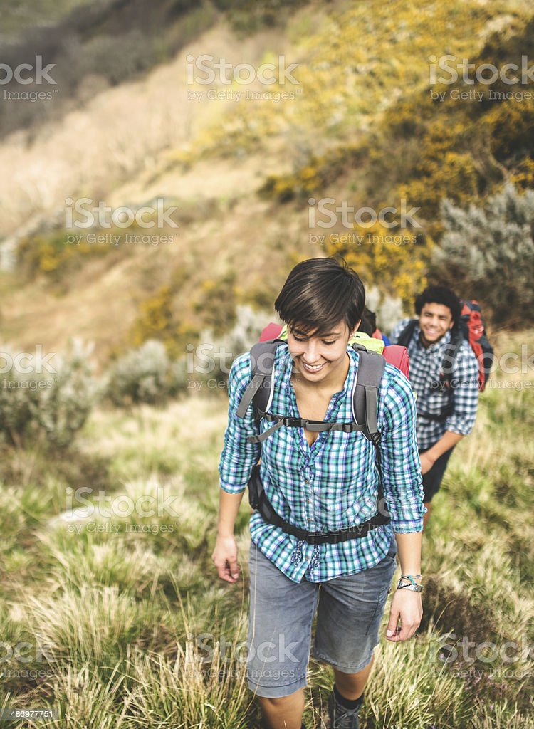 woman hiking on the mountain stock photo