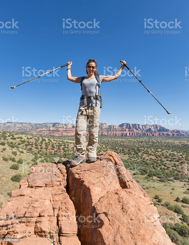 Woman Hiking Outdoors Reaches Her Goal stock photo