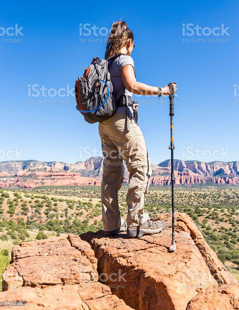 Woman Hiking Reaches Viewpoint stock photo