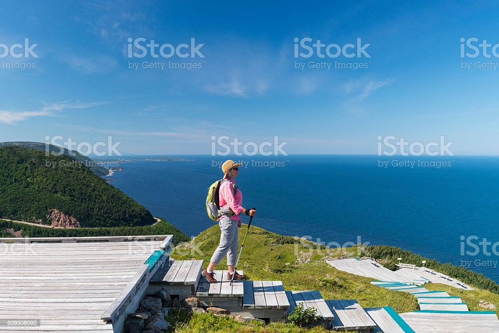Woman hiking, Skyline, Cabot trail, Cape Breton, Nova Scotia stock photo