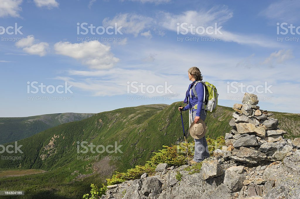 Woman hiking with backpack stock photo