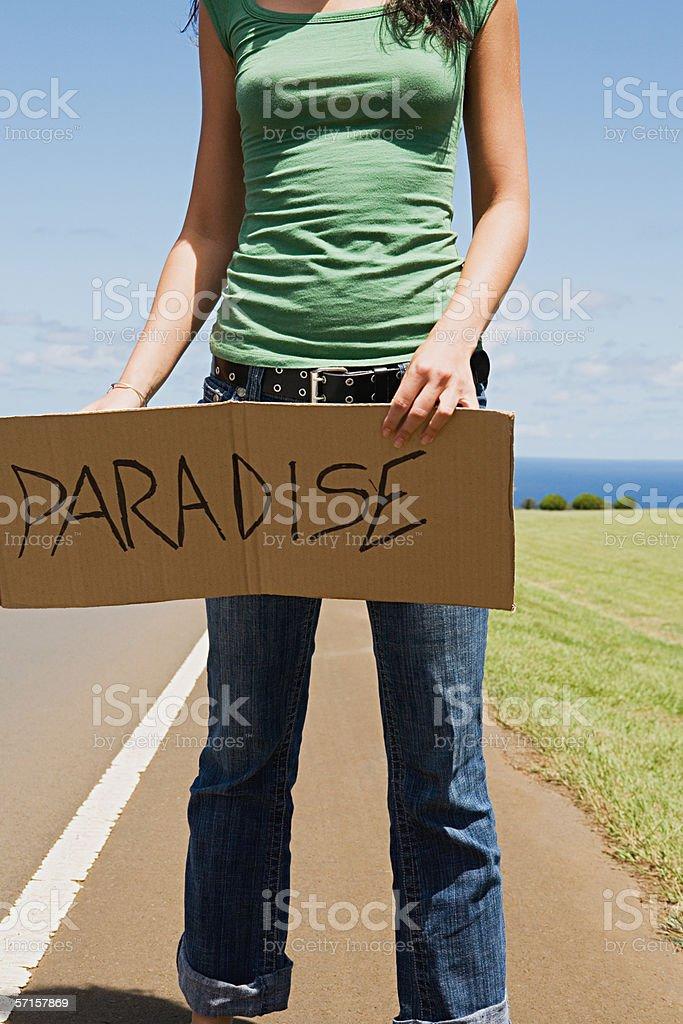 Woman hitchhiking stock photo