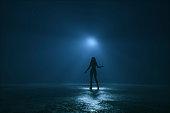 Woman hitchhiking ufo at night