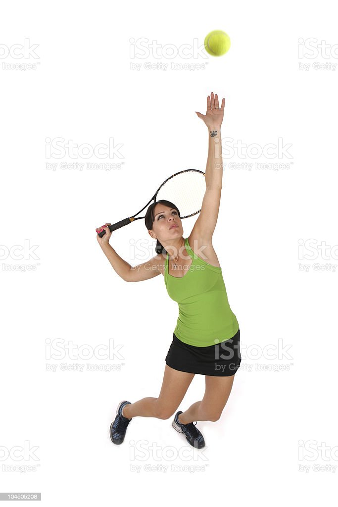 Woman hitting tennis ball on white background stock photo