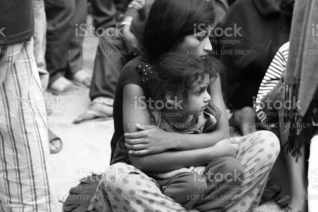 woman hold her child after earthquake stock photo
