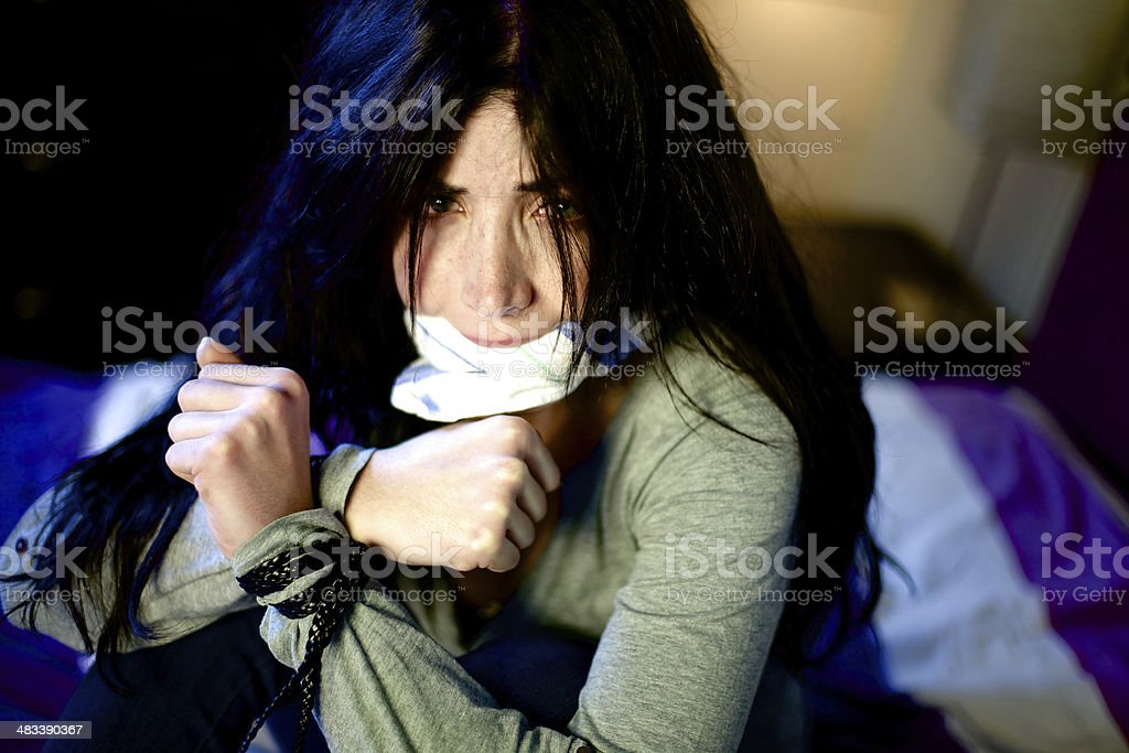 Woman hold hostage at home stock photo