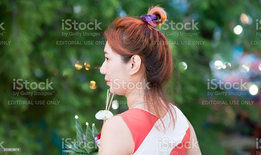 Woman Hold Krathong ,flora basket, in Loi Krathong Day stock photo