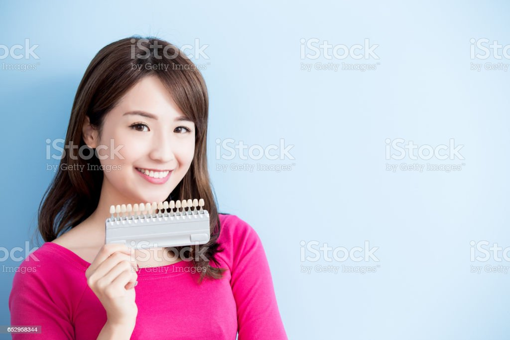 woman hold teeth whitening tool stock photo