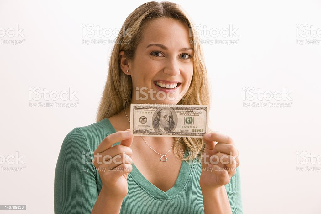 Woman Holding 100 Dollar Bill royalty-free stock photo