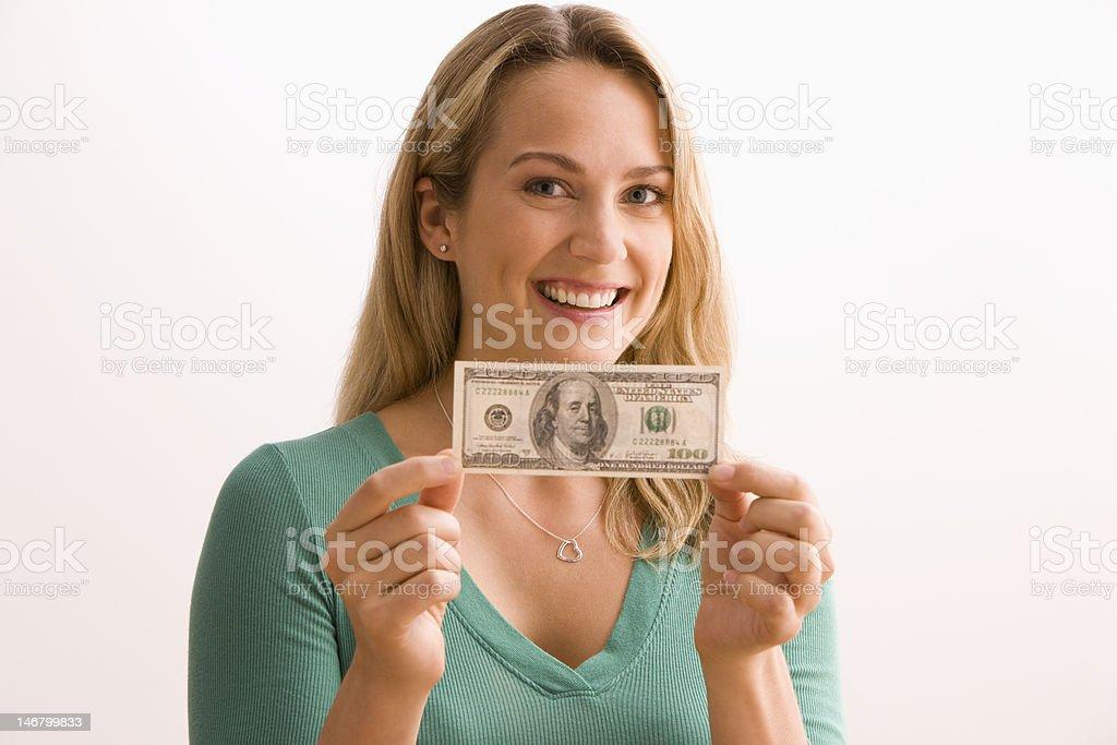 Woman Holding 100 Dollar Bill stock photo