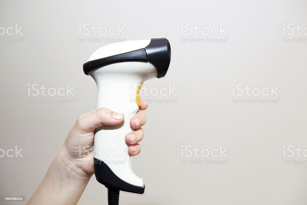 Woman holding a barcode scanner stock photo