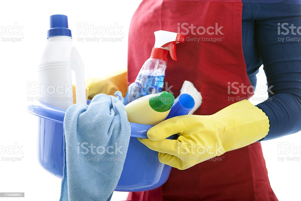 woman holding a basket with cleaning materials royalty-free stock photo