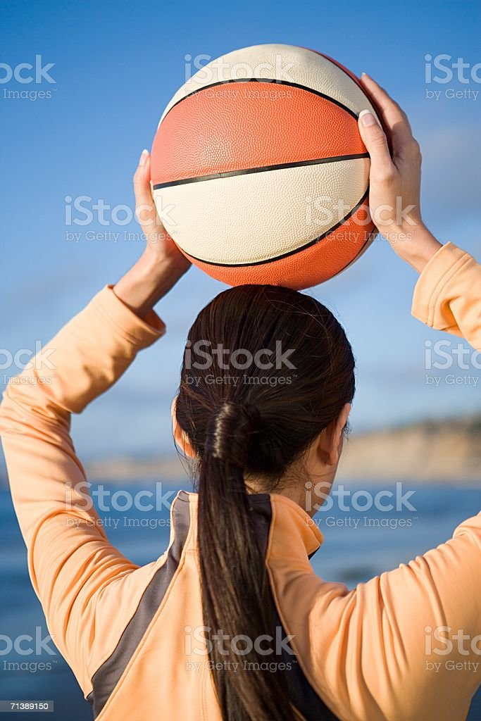 Woman holding a basketball royalty-free stock photo