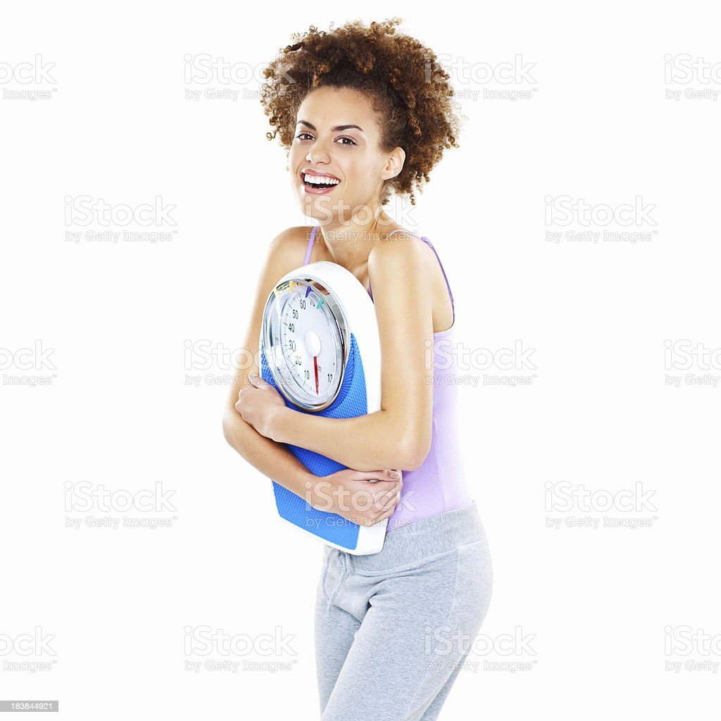 Woman Holding a Bathroom Scale - Isolated stock photo