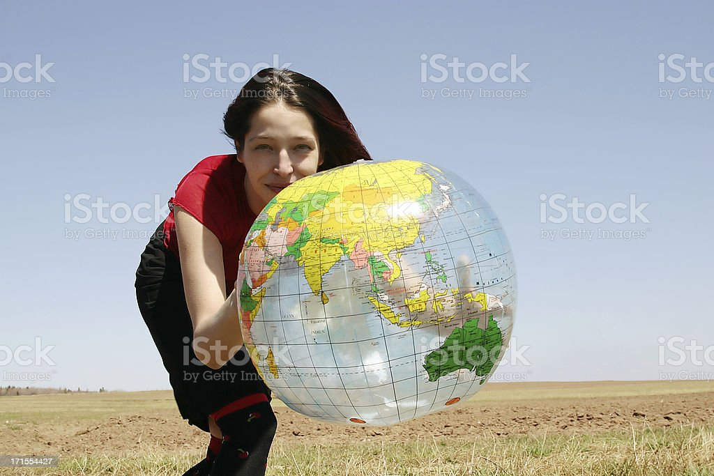 Woman holding a beach ball globe royalty-free stock photo