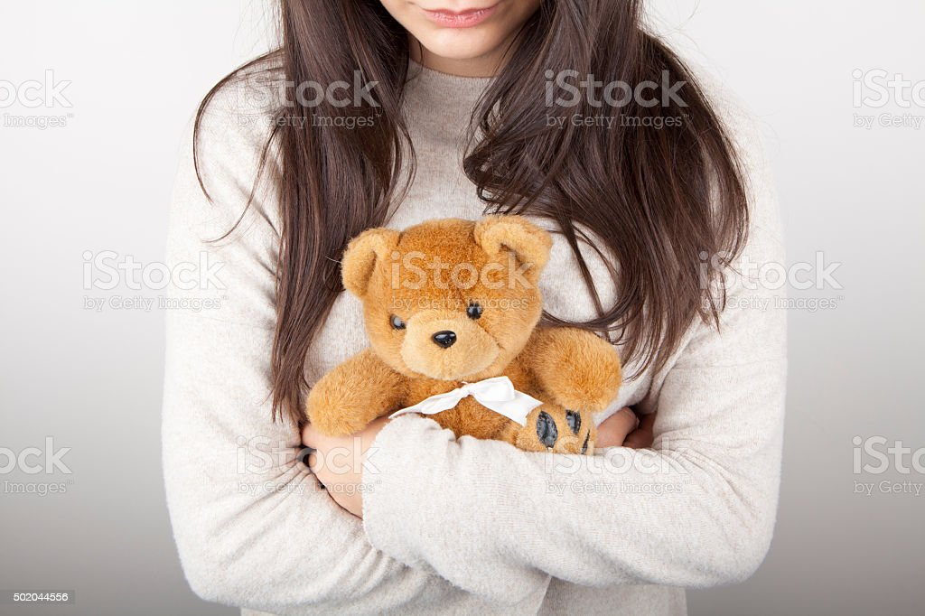 woman holding a bear stock photo