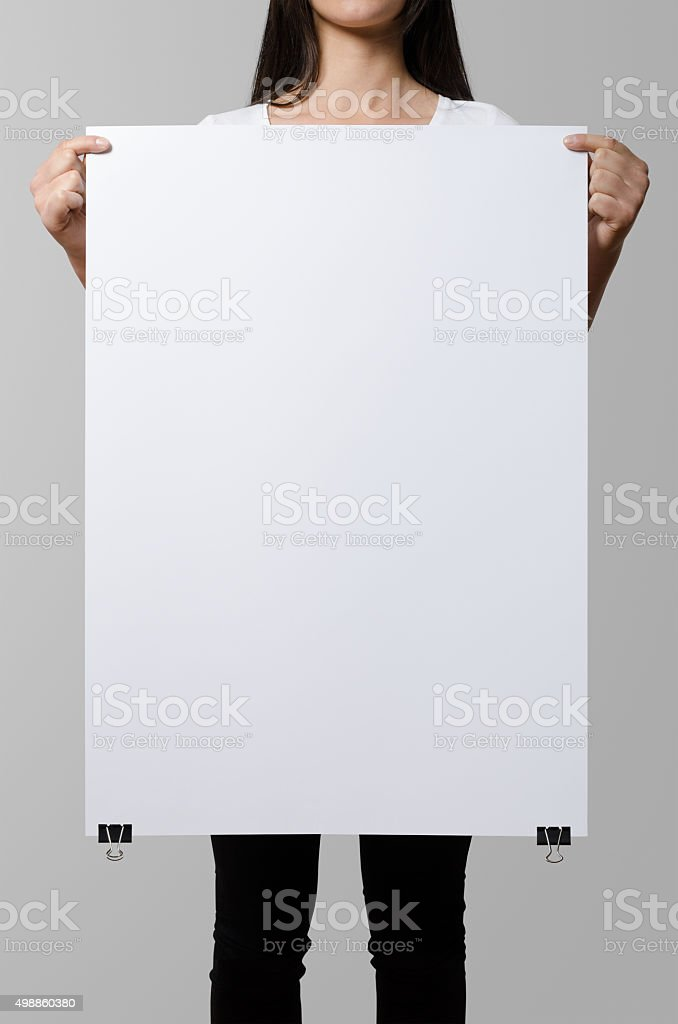 Woman holding a blank poster, square 50x70, mock up. stock photo