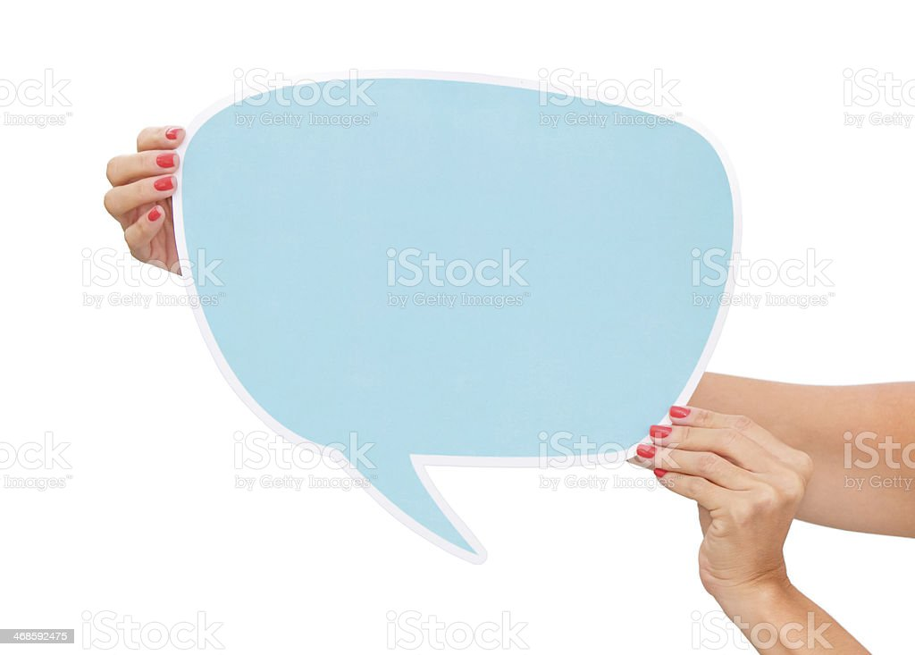 Woman holding a blank sign in shape of text bubble stock photo