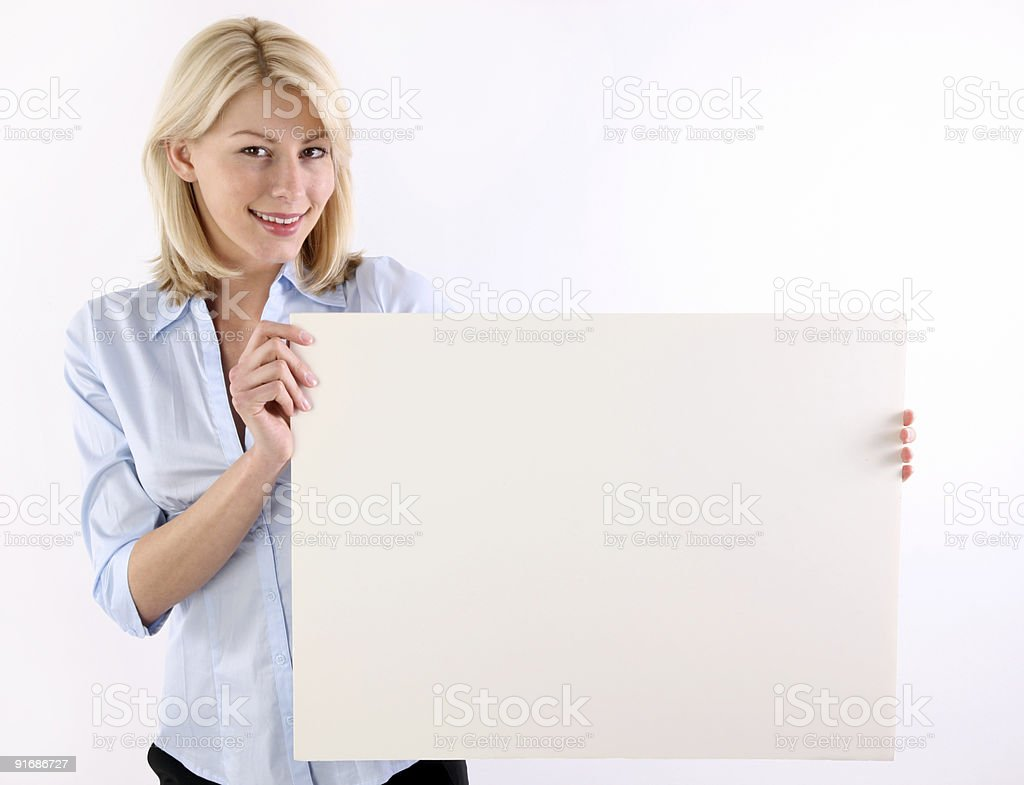 Woman holding a blank sign royalty-free stock photo