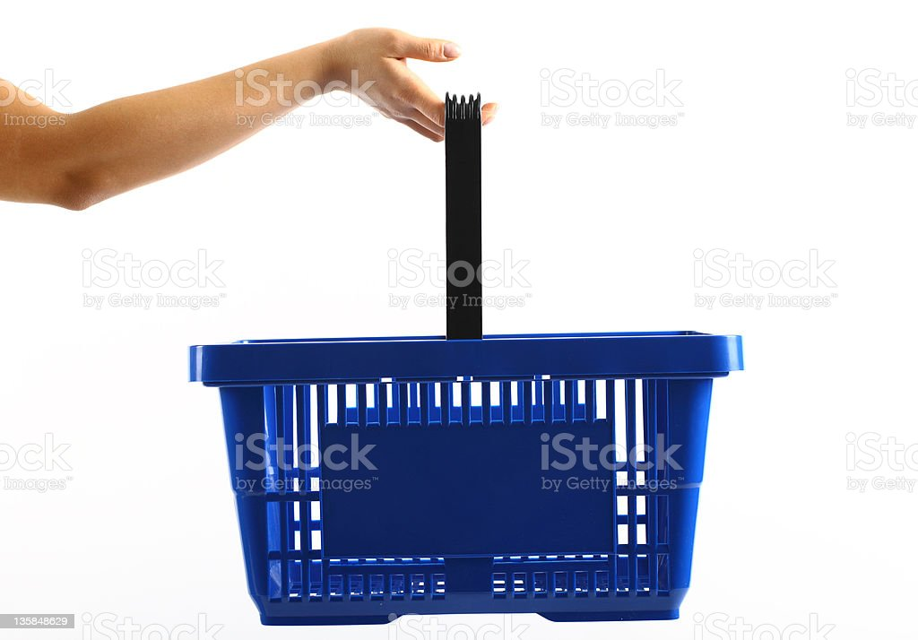 A woman holding a blue shopping basket stock photo