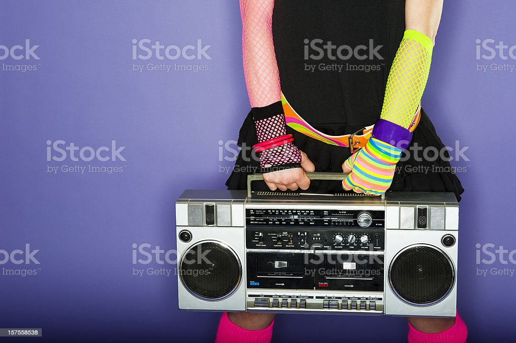 Woman holding a boom box stock photo