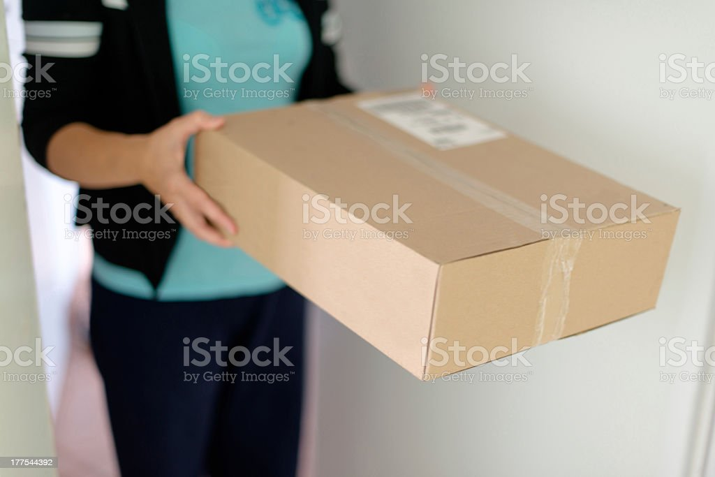A woman holding a brown labeled parcel  stock photo