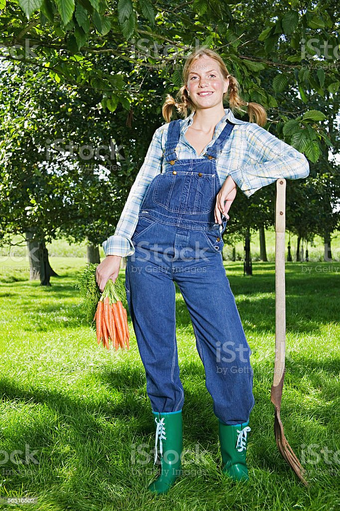 Woman holding a bunch of carrots stock photo