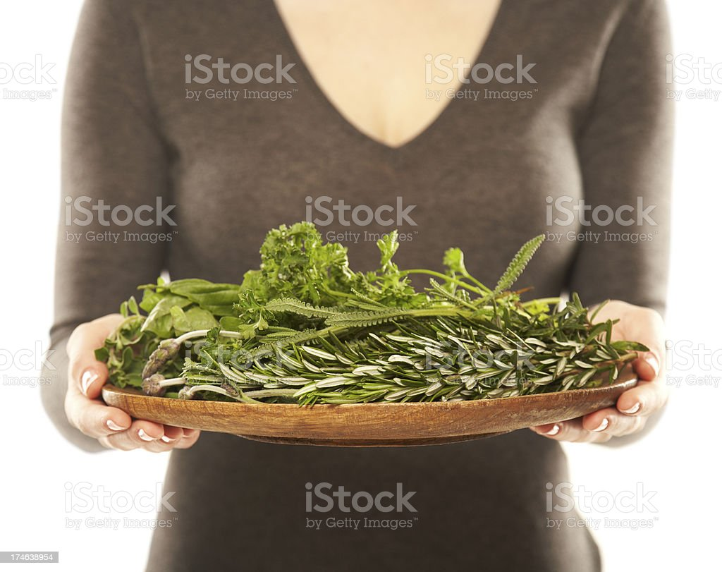 Woman holding a bunch of fresh herbs royalty-free stock photo