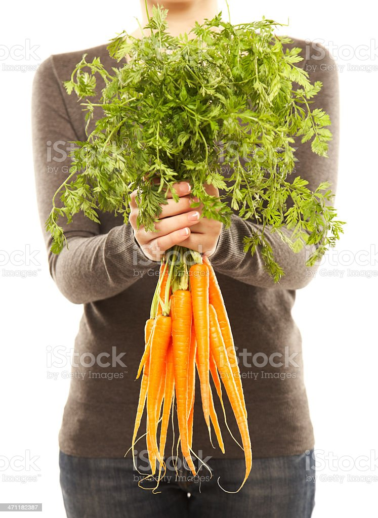 Woman holding a bunch of fresh orange carrots royalty-free stock photo