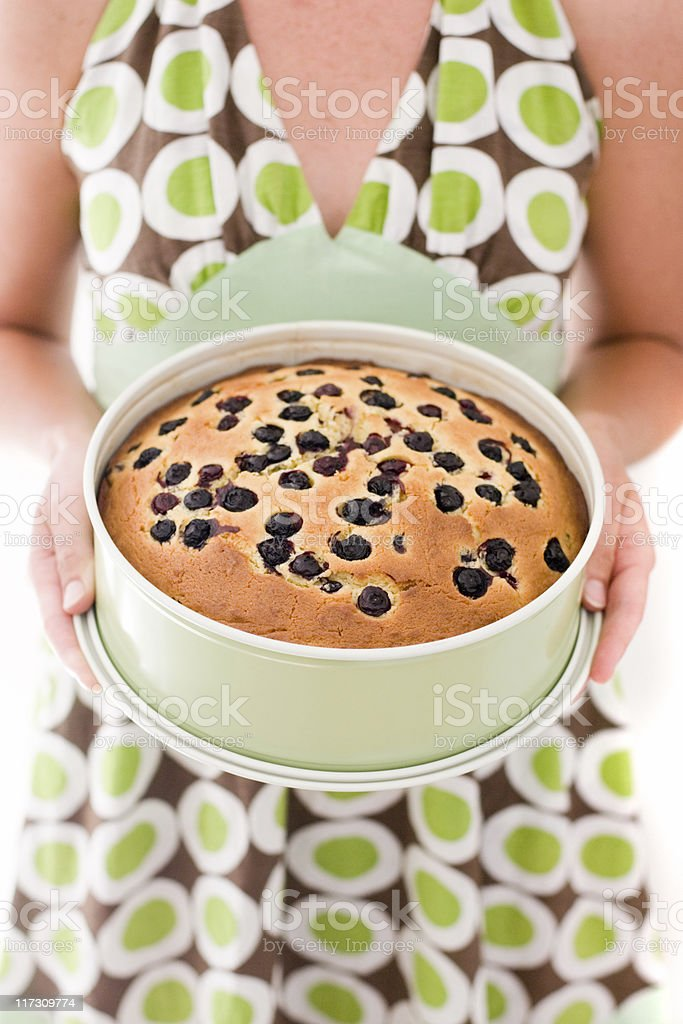 Woman Holding a Cake royalty-free stock photo