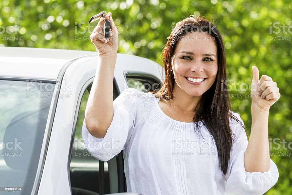 Woman holding a car key royalty-free stock photo