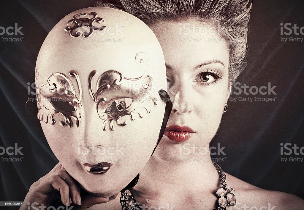 Woman Holding a Carnival Mask stock photo