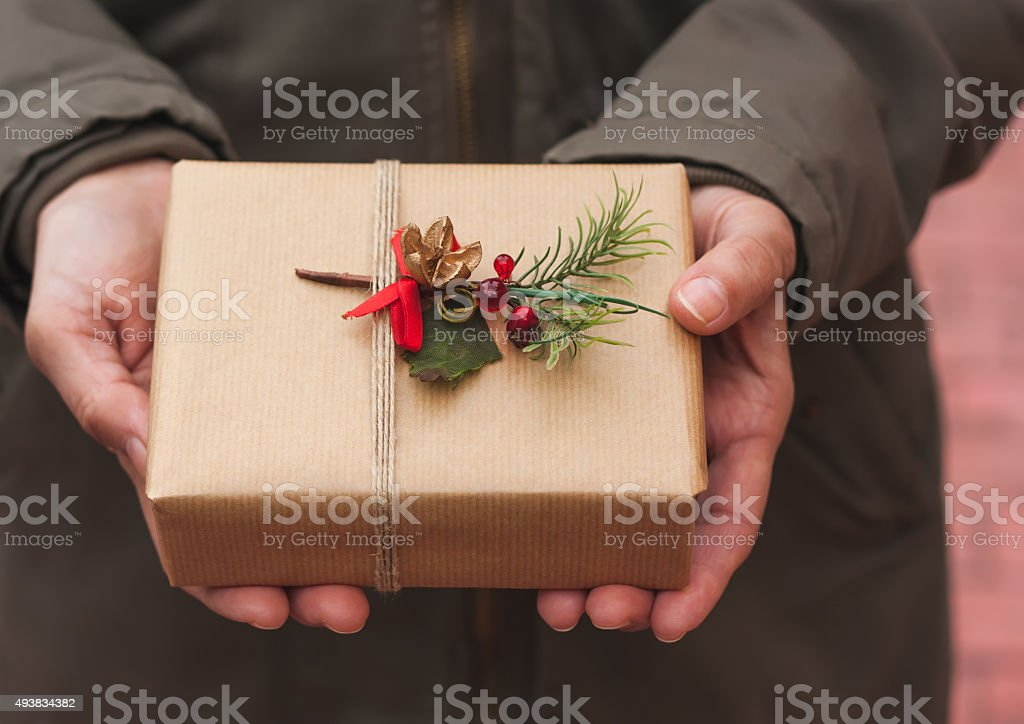 Woman holding a Christmas gift stock photo