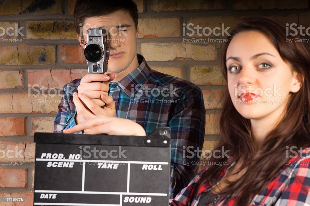 Woman holding a clapperboard stock photo