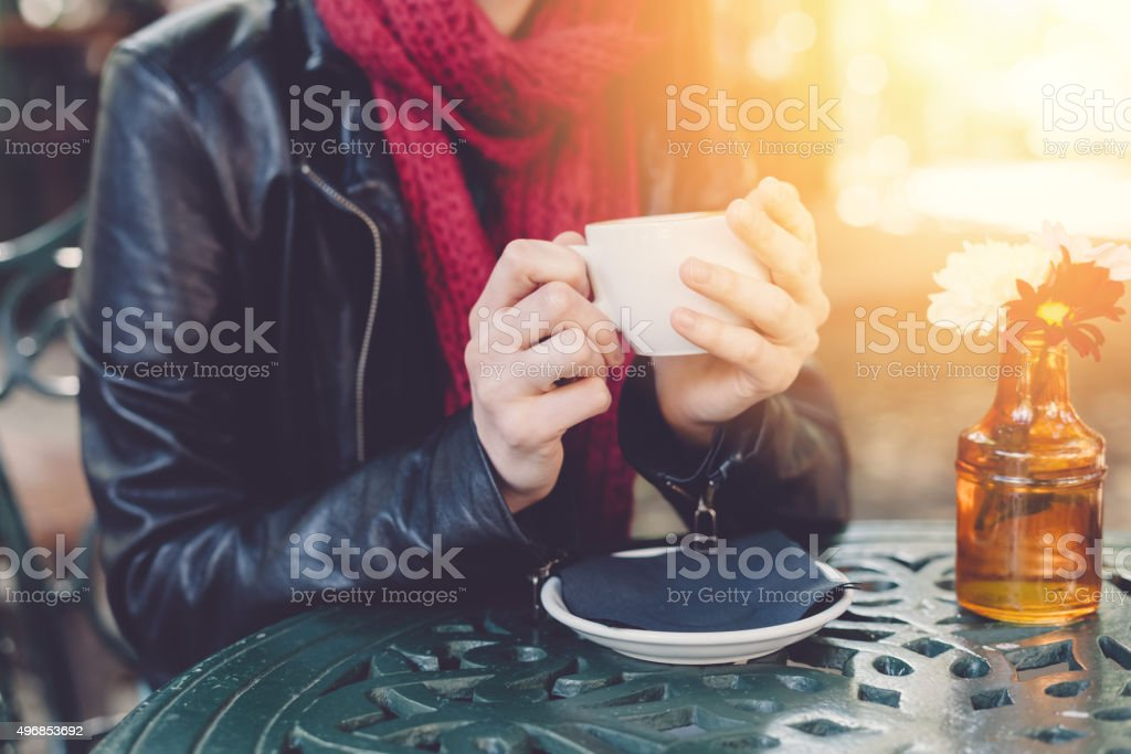 Woman holding a coffee cup stock photo