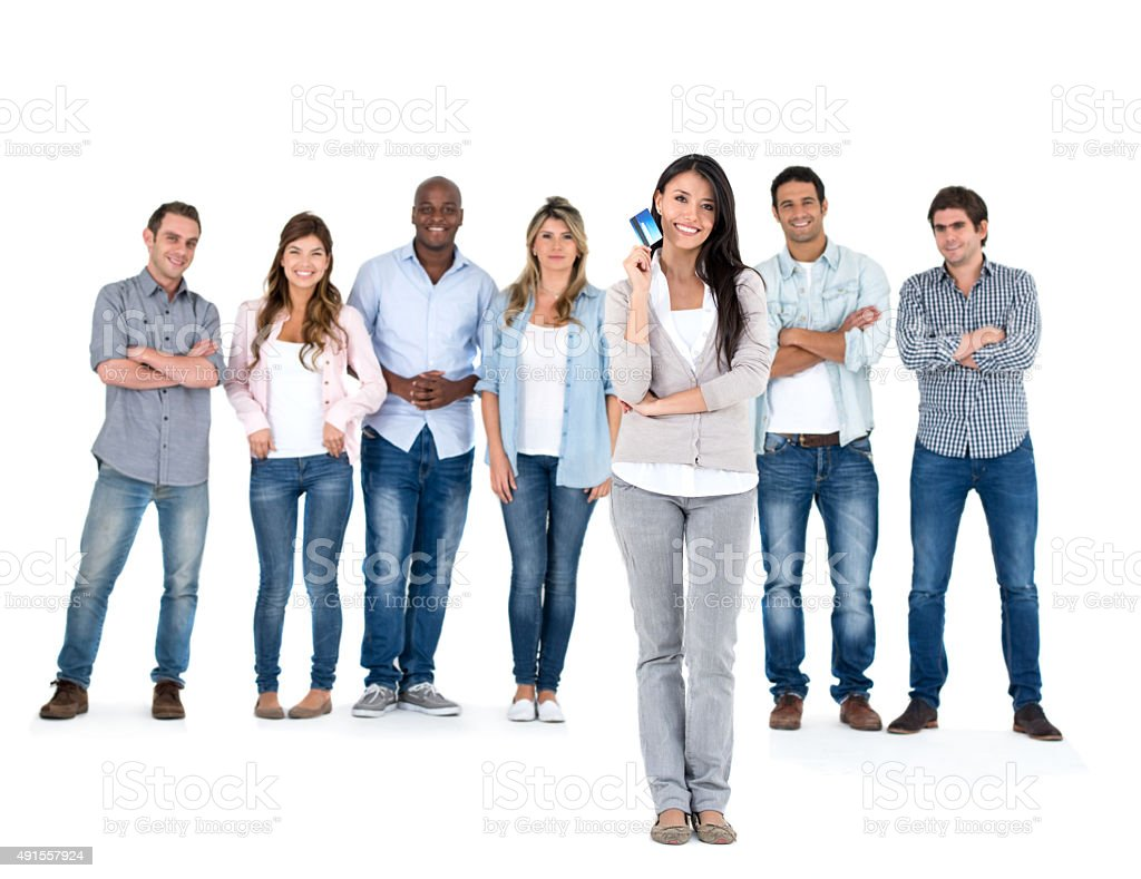 Woman holding a credit card with a group of people stock photo
