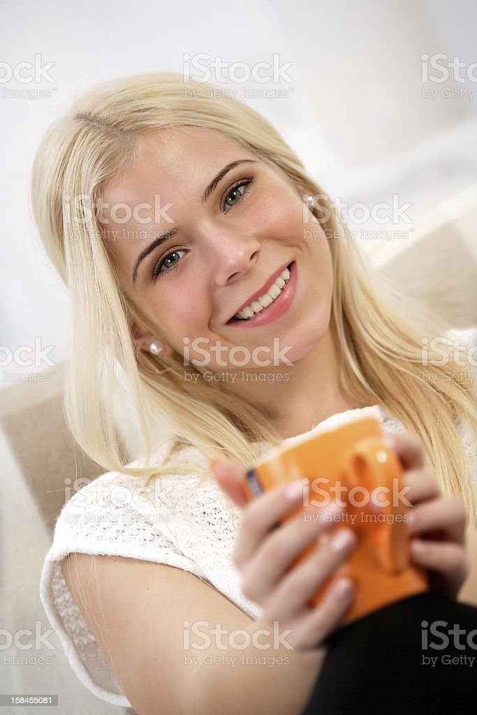 Woman holding a cup of tea royalty-free stock photo