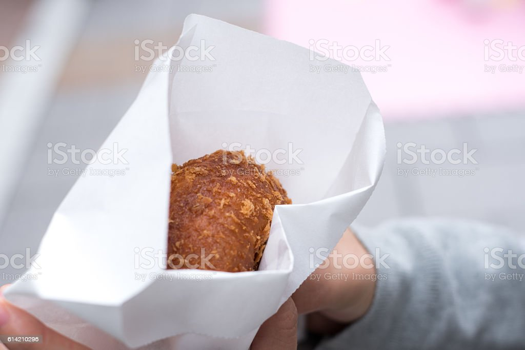 Woman holding a curry bread stock photo