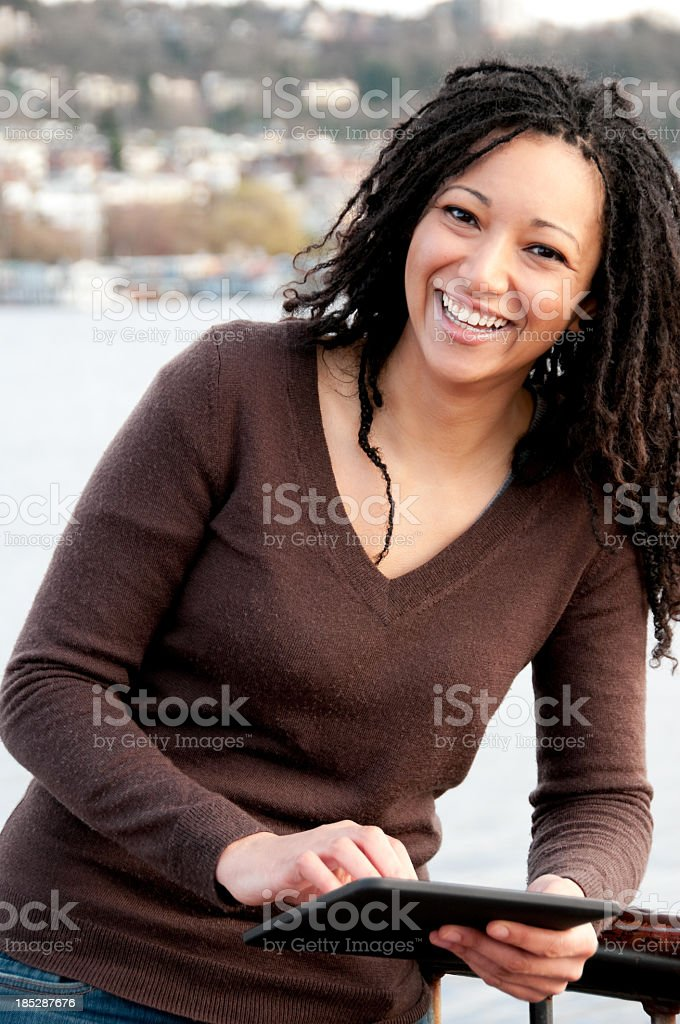 Woman holding a digital tablet royalty-free stock photo