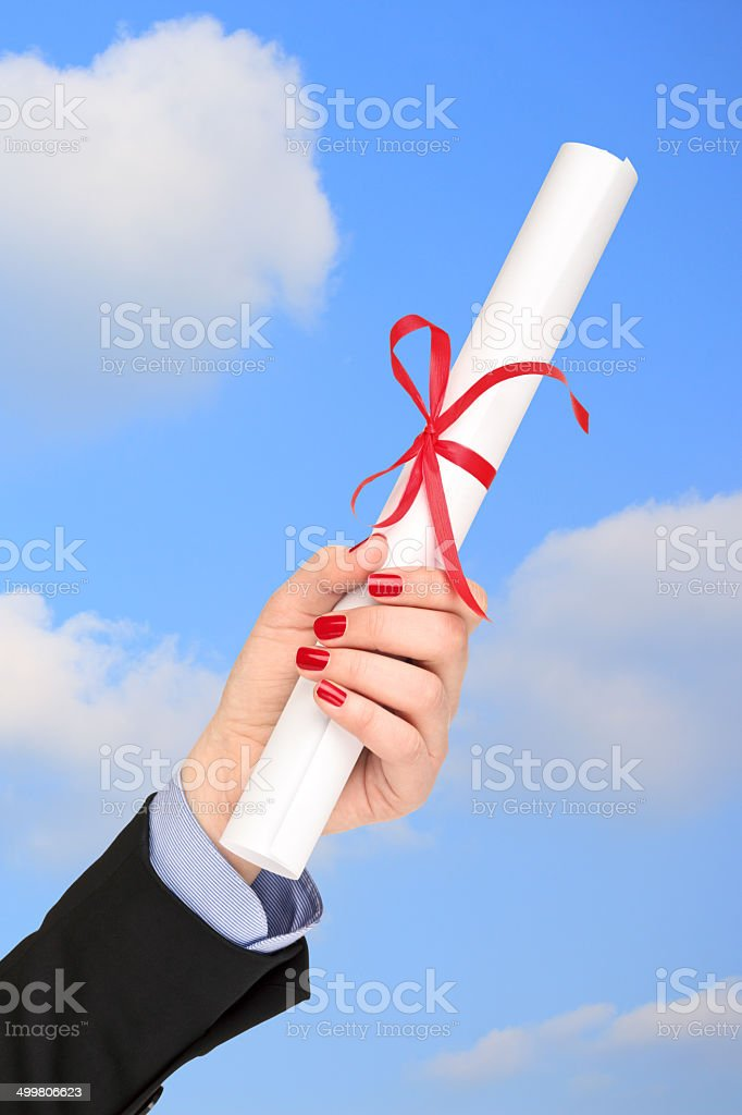 Woman holding a diploma stock photo