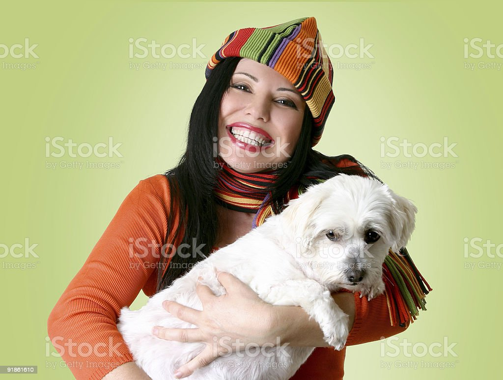 Woman holding a dog in her arms stock photo