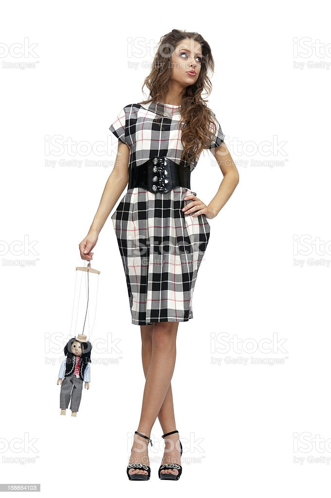 woman holding a doll puppet royalty-free stock photo