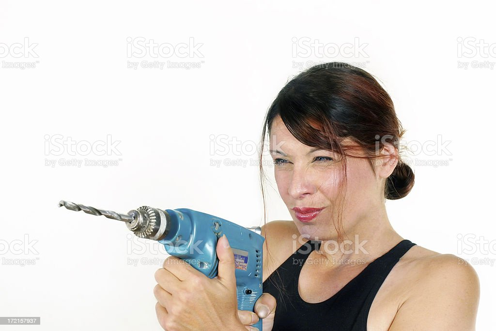 Woman holding a drill royalty-free stock photo
