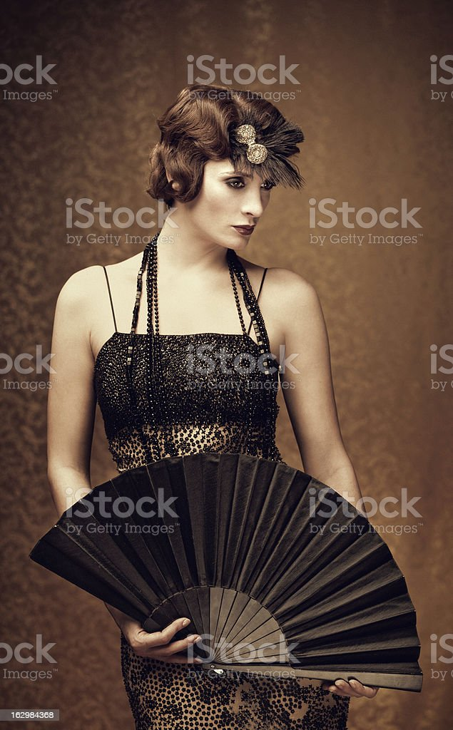 woman holding a fan - vintage style stock photo