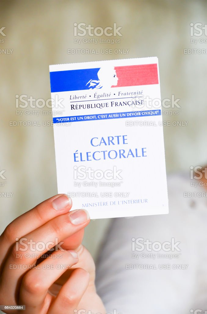 woman holding a french election card stock photo